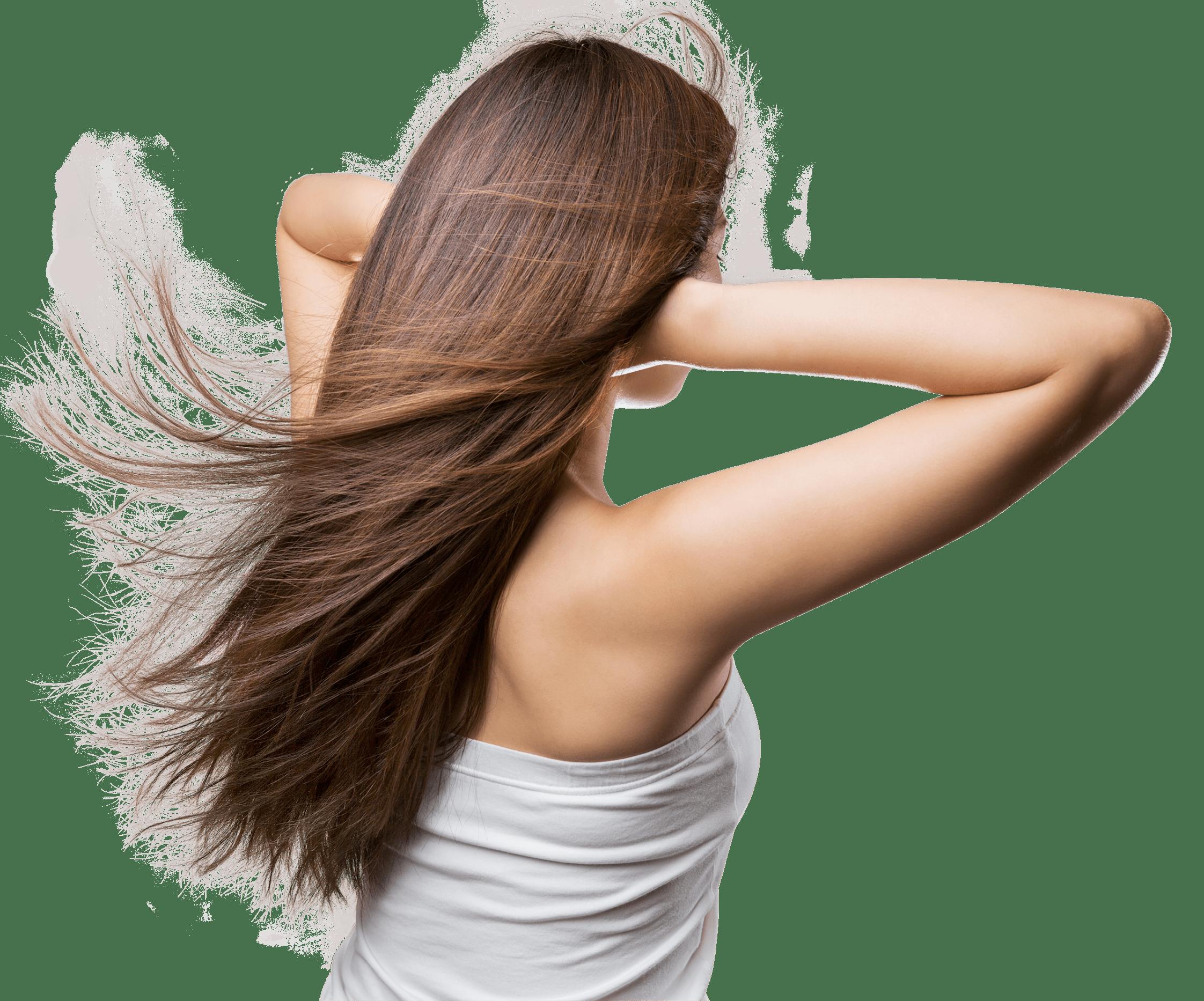 髪をかき上げる女性の写真